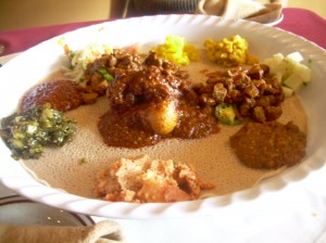 A communal plate of injera with all the fixins is messy but delicious.